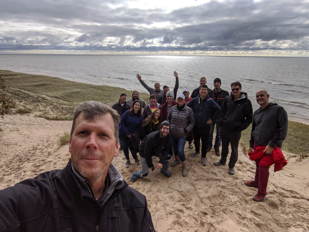 "EQI team celebrating they completed the ""dune climb"""