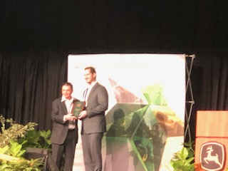 Brian DeVasConCellos receiving the preferred Supplier award at John Deere Supplier Conference